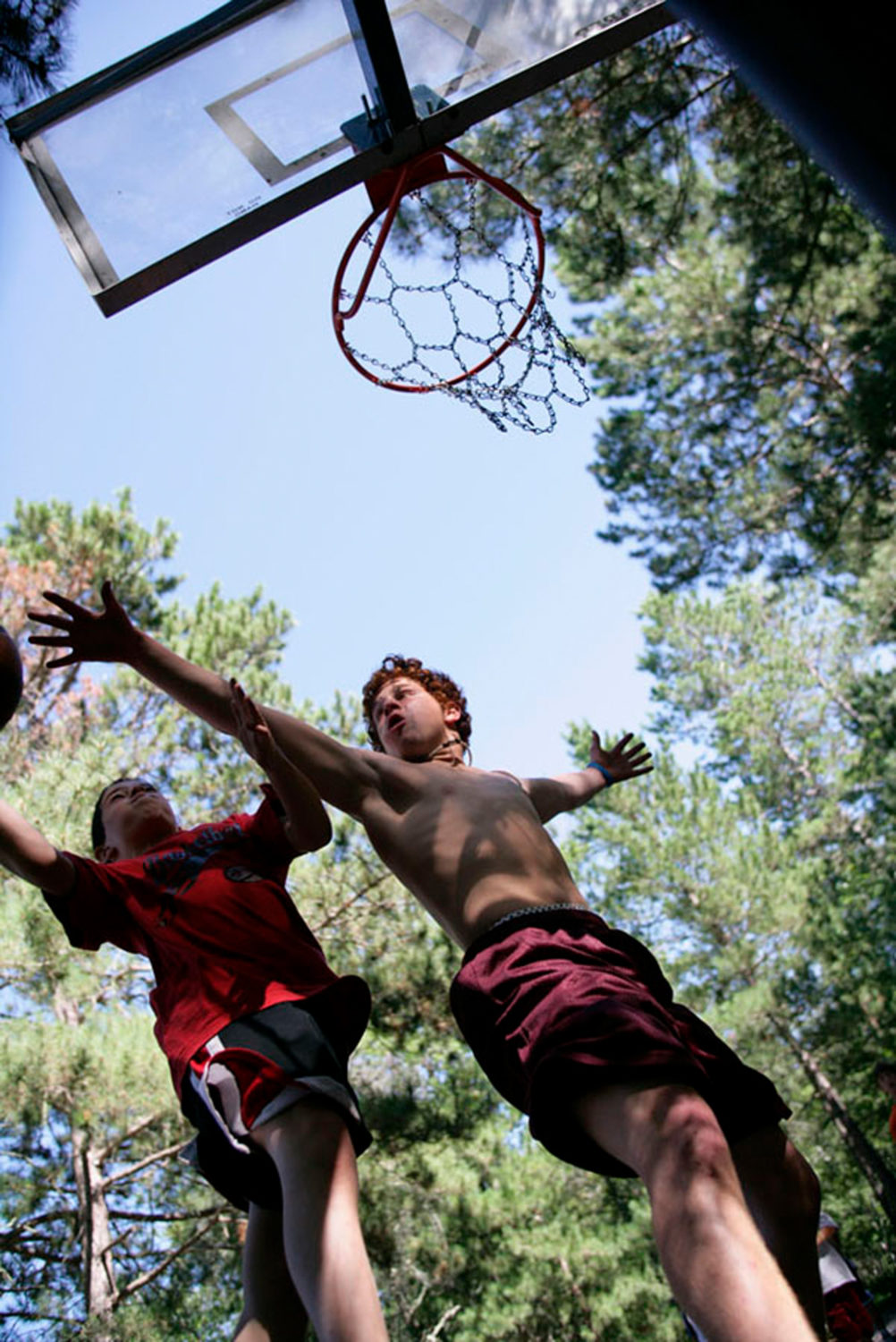 Boys playing basketball at Camp Thunderbird