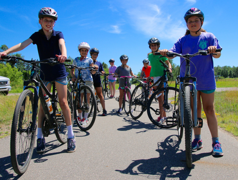 Kids biking together on a trail