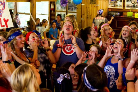 Counselor leading girls in song at Camp Thunderbird