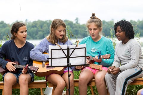 Girls singing during a summer camp activity
