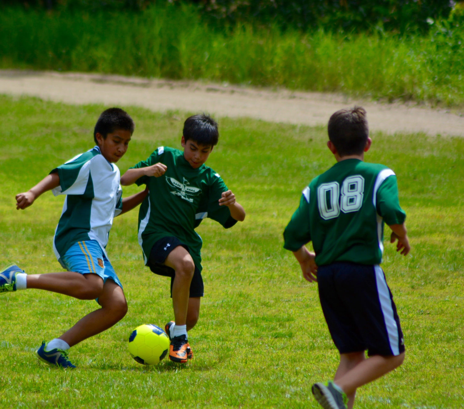 Boys playing soccer at boy's summer camp