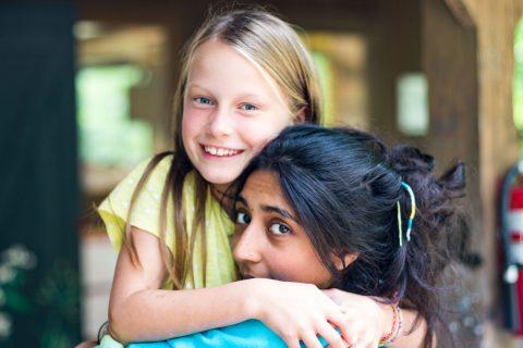 Camp Thunderbird girls councilor hugging a camper