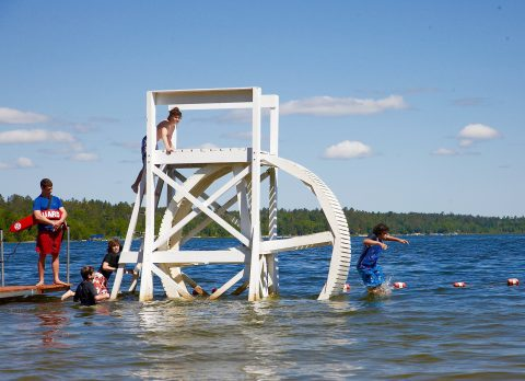 Children playing in the lake at Camp Thunderbird