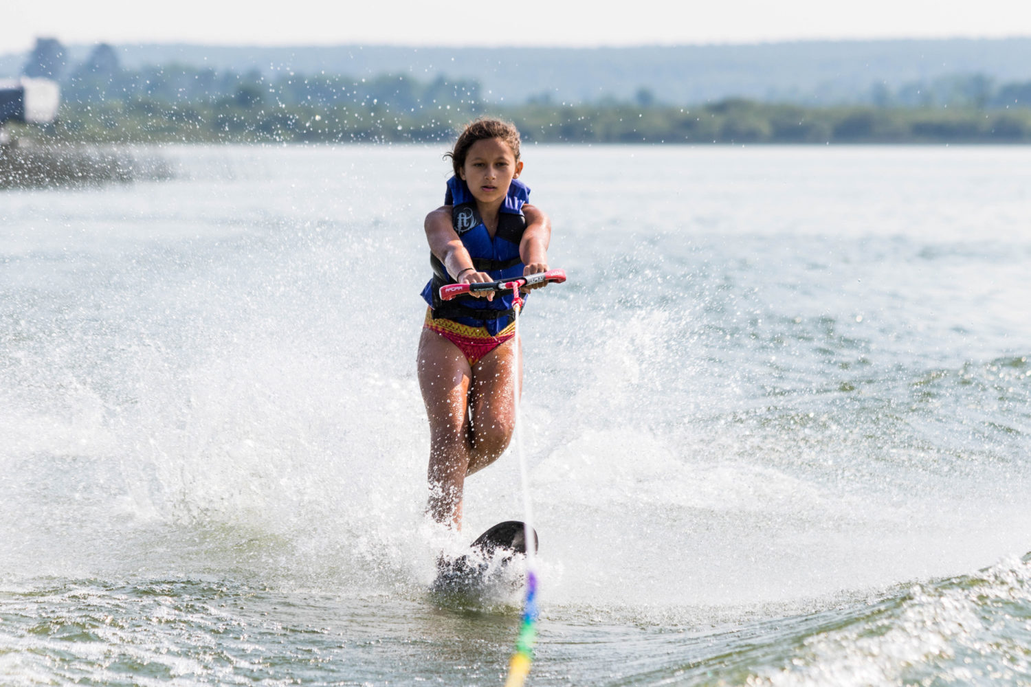 Girl water skiing on the lake